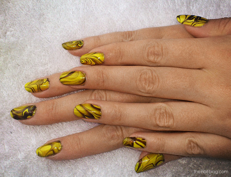Yellow water marbling nails
